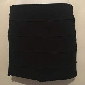 Black body con stretch skirt with zipper back.